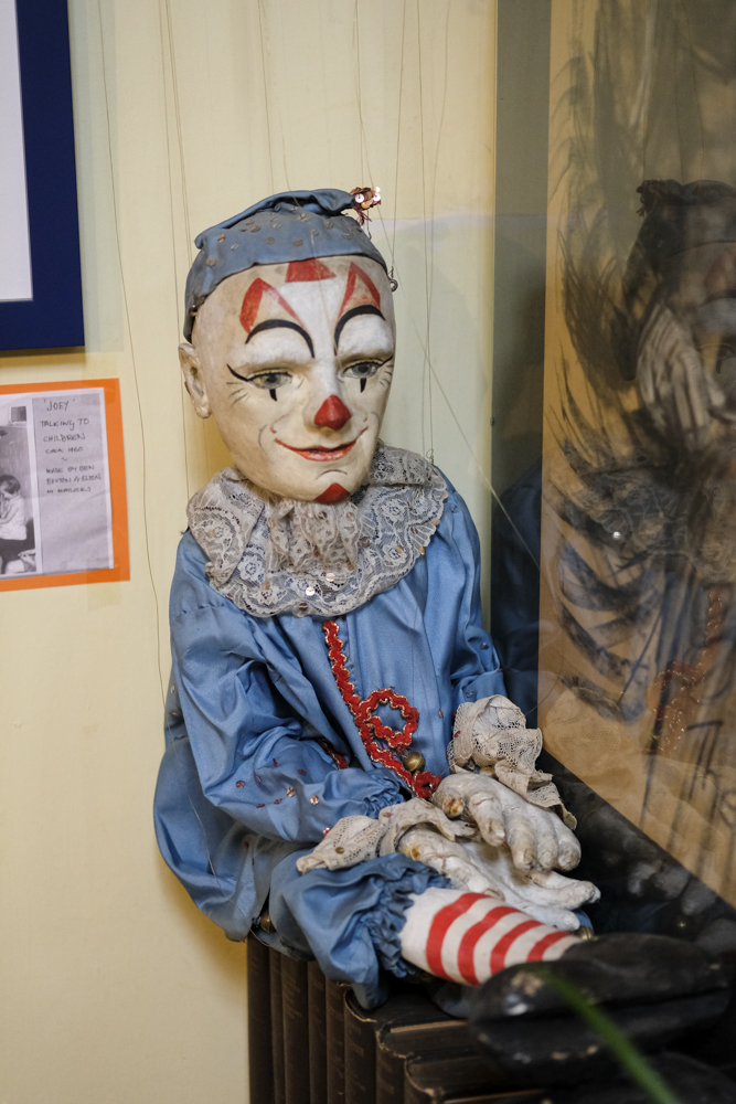 Clown puppet inside Scrivener's Book Shop in Buxton