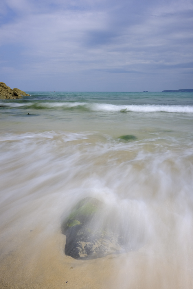 Water flowing up the beach at Carbis Bay in Cornwall