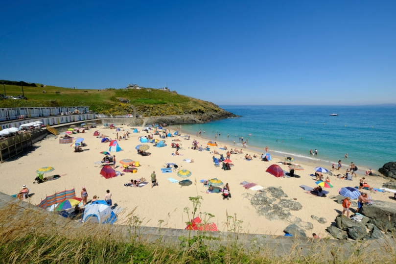 People enjoying a summer's day on Porthgwidden beach in St Ives, Cornwall