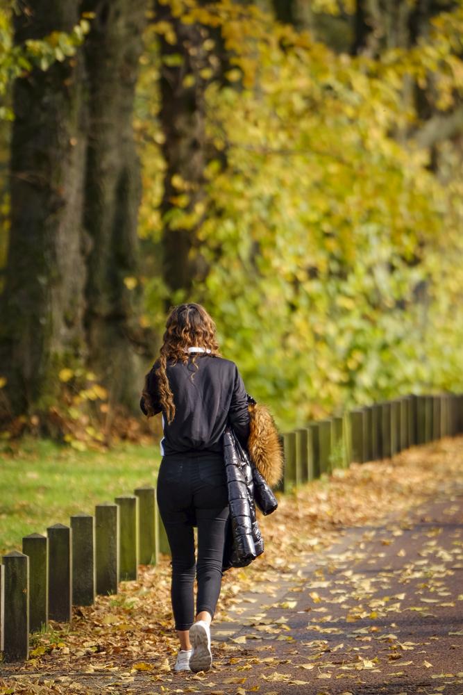Young women walking along park path