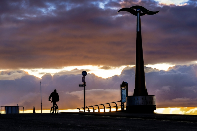 A cyclist riding along the promenade at Southport